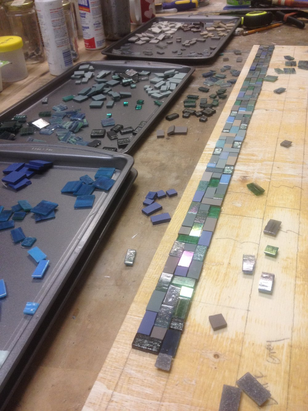 Custom mosaic panel inspired by the James River in progress in the mosaic studio.