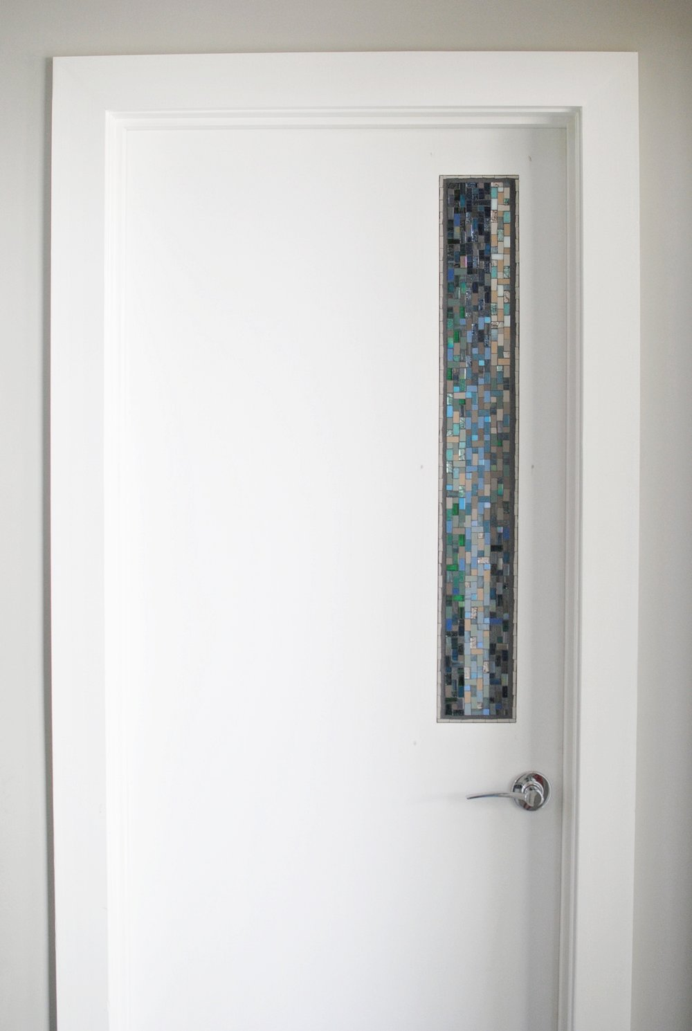 Custom mosaic panel installed in a front hall door