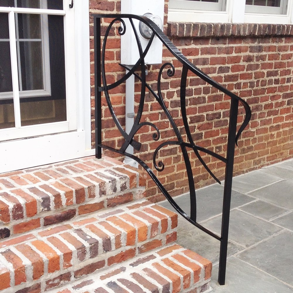 There you have it! The finished product, a custom hand-forged stair rail, painted and installed in the brick steps and slate patio.