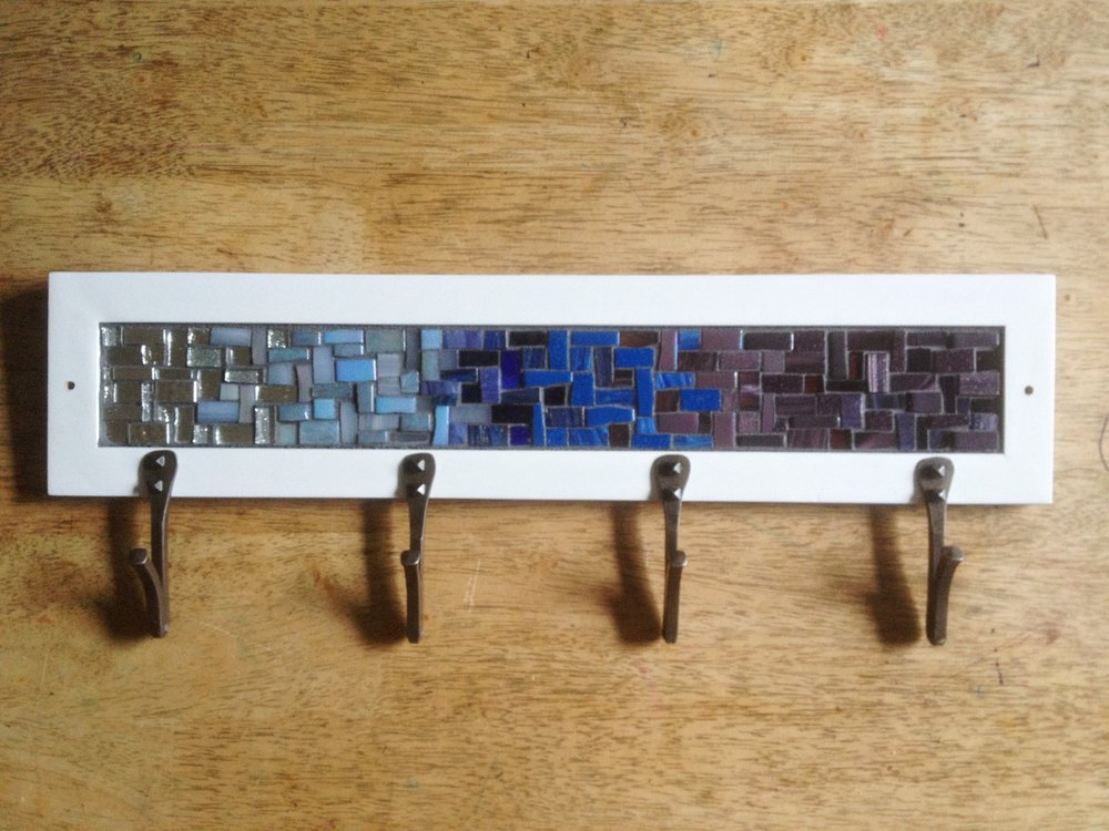 Mosaic coat rack with custom white frame