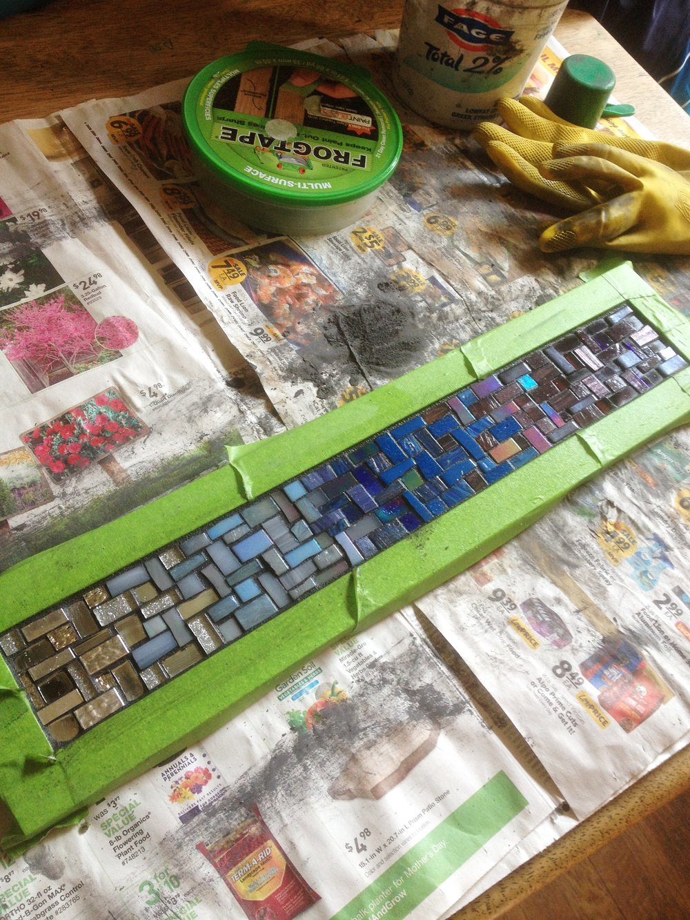 Grouting a custom mosaic coat rack