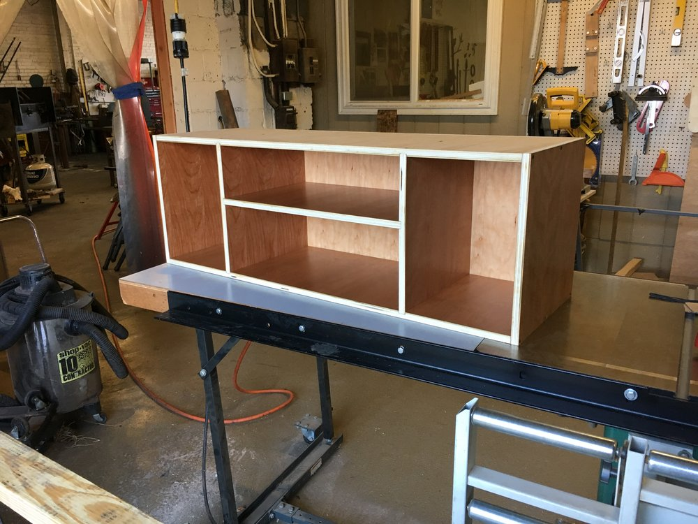 Media console carcass construction in cherry PH2016