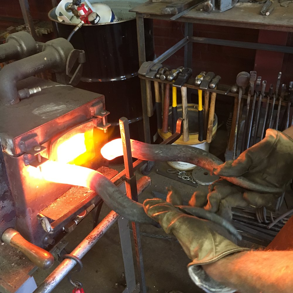 Heating door handles in the gas forge
