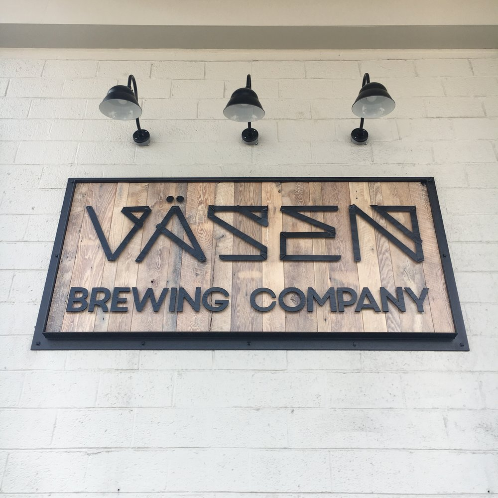 Forged sign on reclaimed wood at the Vasen tasting room