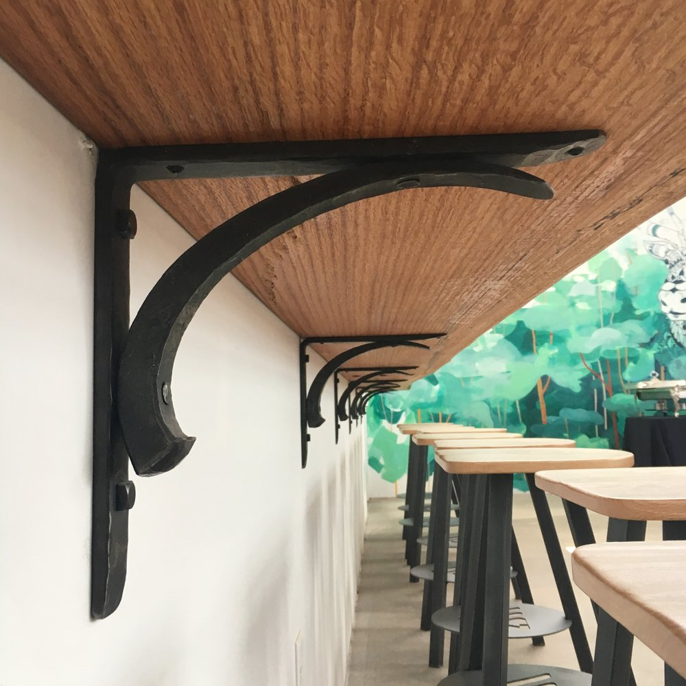 Forged bar brackets in the Vasen tasting room