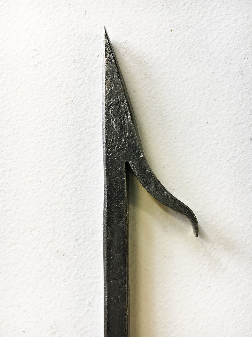 Fire poker with log hook detail