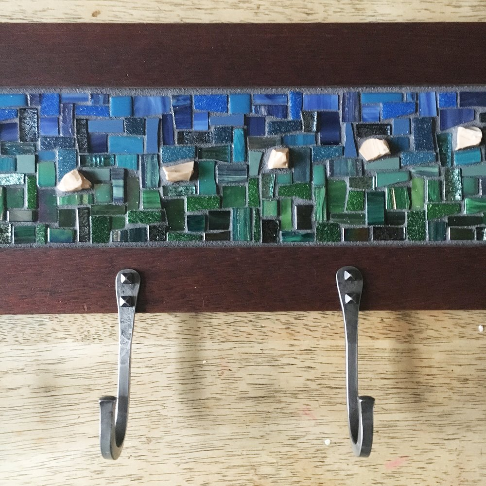 Blue green mosaic coat rack detail