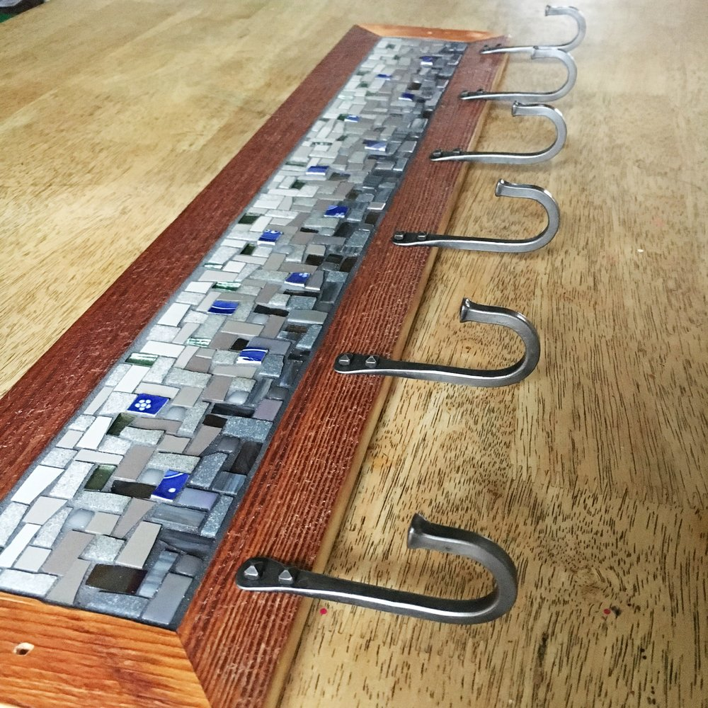 Grey blue mosaic coat rack detail