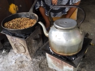 While waiting for the army to arrive to escort us to Gondar, we hung around the border town. At the Coke stop, the lady roasted coffee beans. -