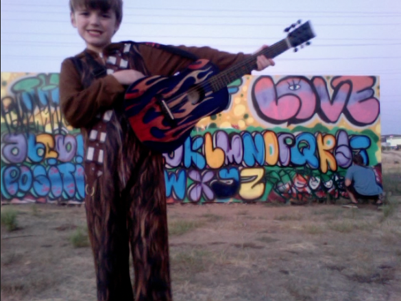 "Hey look Chewbacca playing guitar. . .  nope. Jacob will tell you his wookie costume is ""Just a pajama. I'm Terri Clark!"""