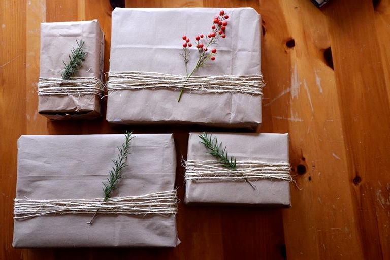the presents i wrapped using branches from my parents' yard, twine, and inside out Trader Joe's bags :)