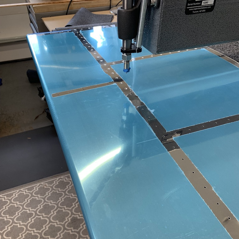To access the holes located toward the leading edge, I pulled the table out to help support the skin. The process requires constant attention to avoid punching a hole through the skin in the wrong place.