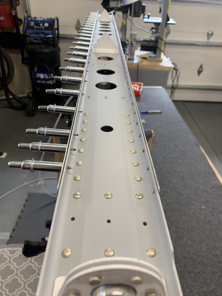 After riveting all the ribs, I installed the rear-spar assembly and clecoed in place and set the LP4-3 pop-rivets , then used the squeezer to set the rivets that attach the spar to the skins.