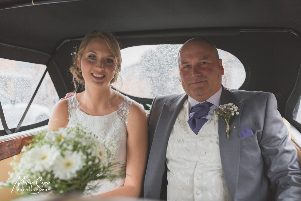 Bride and Father of Bride in Wedding Car