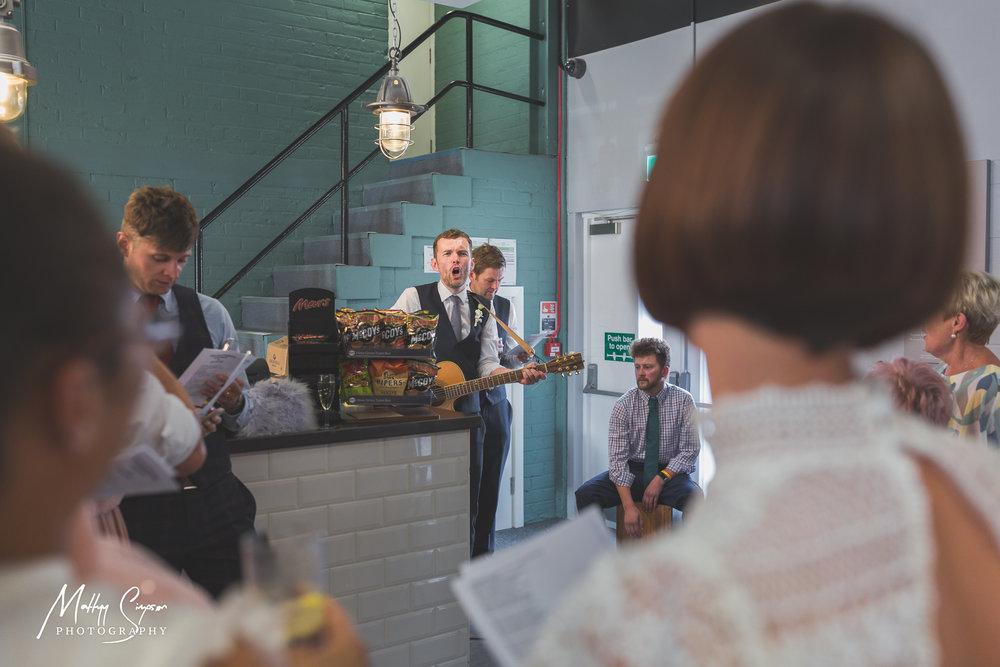 Groom Singing to Bride