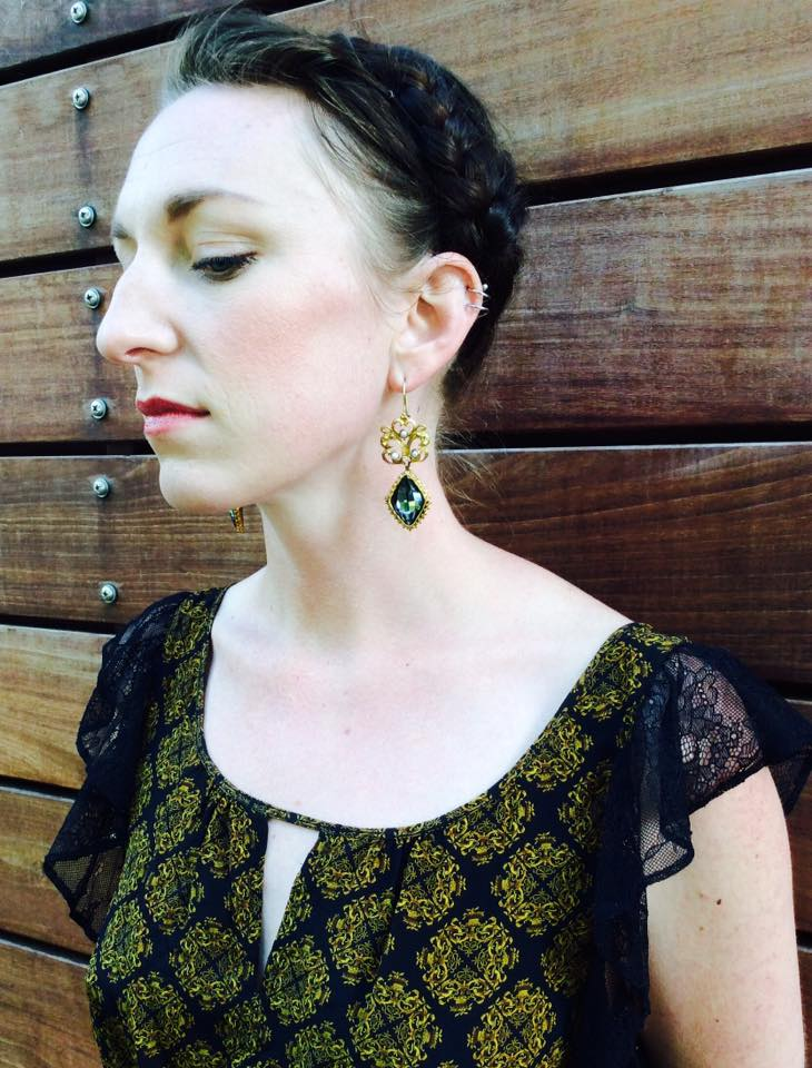 Lindsay doubles as not only being shopgirl supreme but store model as well. Looking good in these uber blingy earrings from Gypsy Handmade.