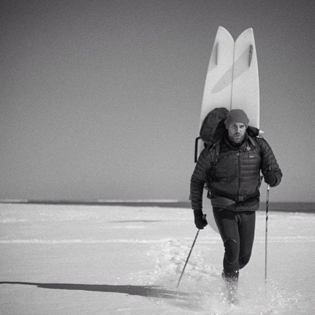 Tyler Breuer of Smash Surf heads out to surf on a snowy winter day in 2015