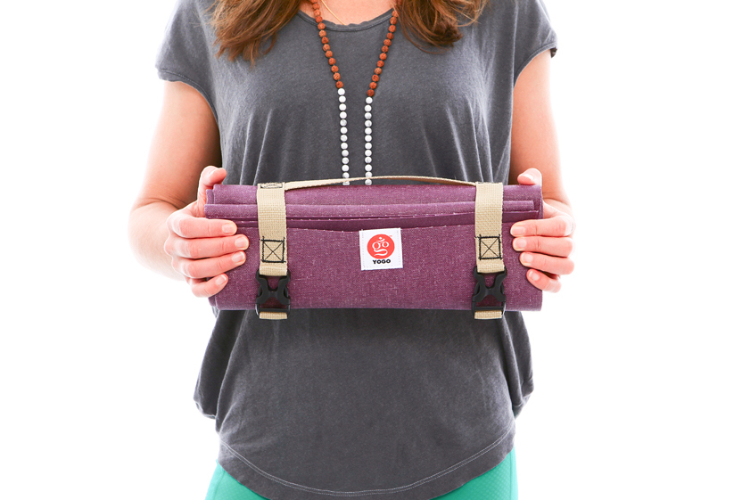 YOGO Ultralight Travel Yoga Mat - with Integrated Straps and Handle$64.99The YOGO Mat is *the gift* for any urban yogi (seriously, look how small it gets!) but especially those who are heading out on a hike, into a park or to the beach to find their zen. The ultra-light mat, offered in charcoal, plum and forest folds up and buckles with integrated straps and a handle so you can stow it in a small bag and literally take yoga anywhere. Bonus: the mat is made with natural tree rubber and YOGO plants one tree per mat.