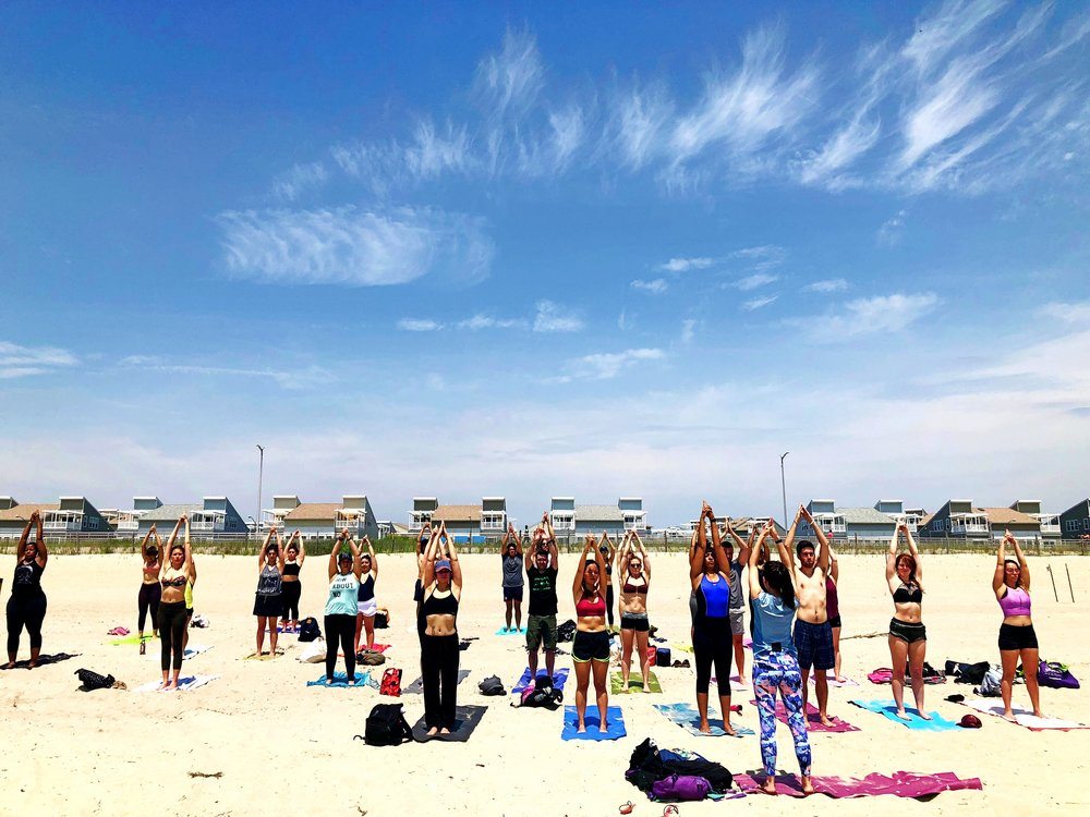 Angelica Olstad of Pop Up Yoga NYC leads beach yoga. Photo by Hanna Sender