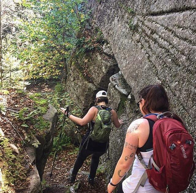 Melanie and Kristina finding their way around ledges on a guided bushwhack with Catskill Mountain Wild.