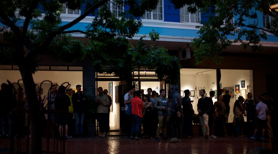 The scene outside Worldart on the opening of an exhibition by Ello and Black Koki. Image: Worldart