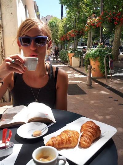 Consuming coffee and croissants like a pro.