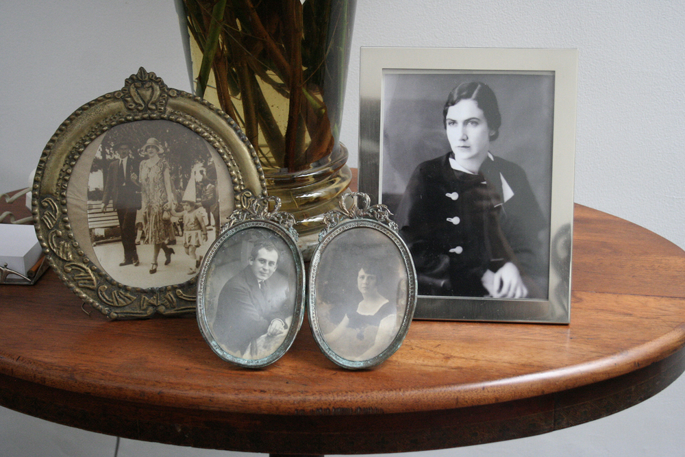 The table in the entrance foyer at my grandparents' house. At Left, a picture of my grandfather's parents, Ulpiano and Emma. I'm not sure, but I think the picture in the middle is of my grandmother's parents (i'll update this caption once i know for sure). The majestic woman on the far right is Mama Emma, grandpa's mother.