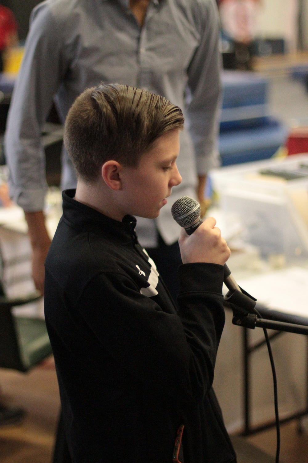 Matty singing national anthem.JPG