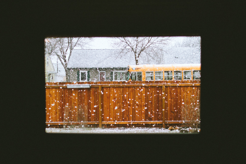Snow out a Minneapolis window with a school bus
