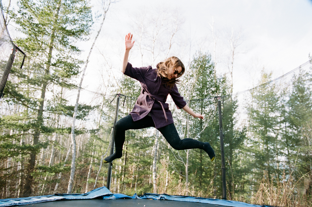 Woman laughing on a trampoline