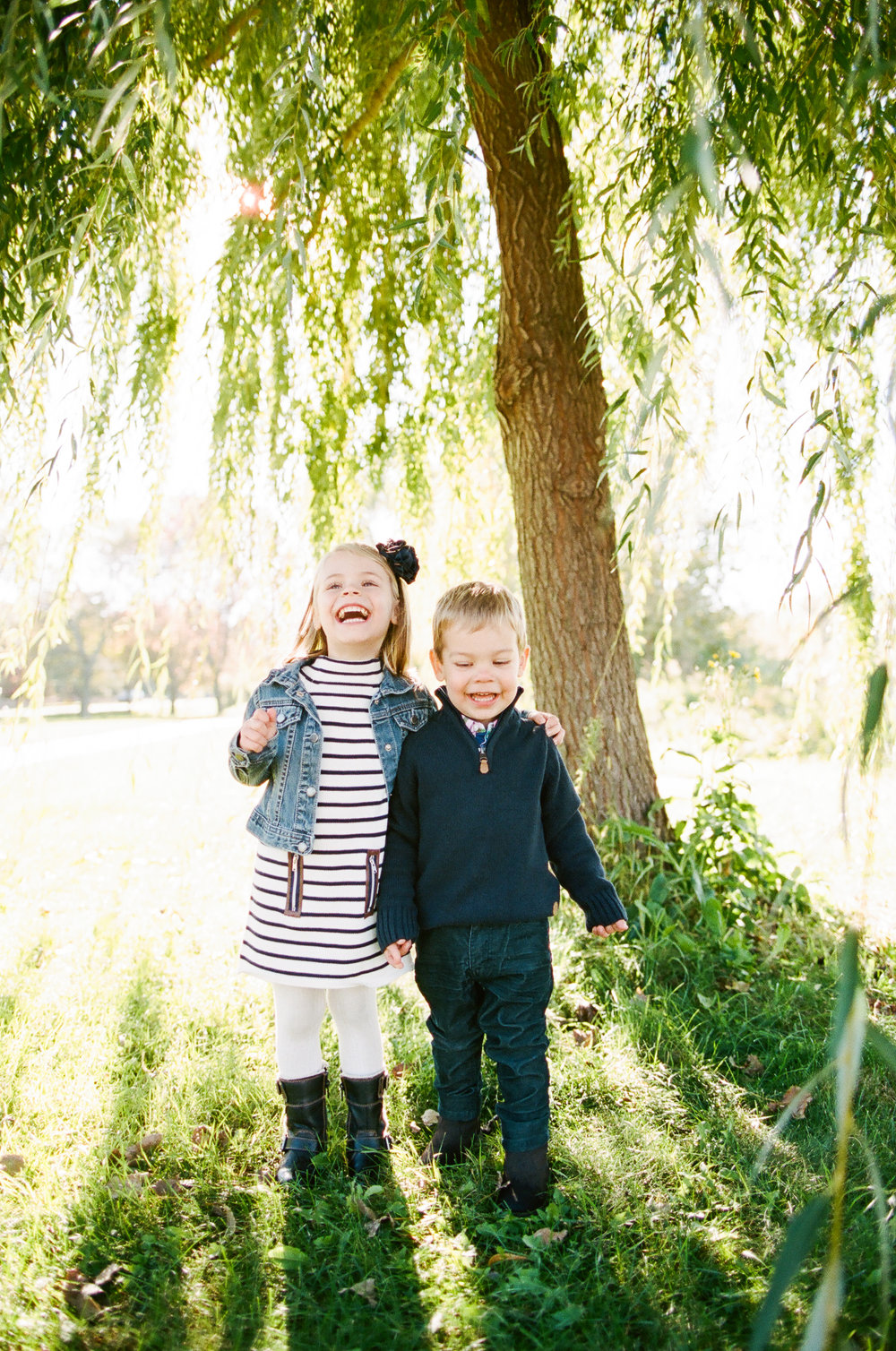 Siblings under a Willow Tree in Minneapolis, Minnesota