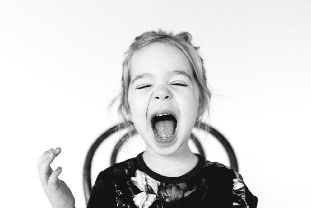 Kid screaming in a photo studio