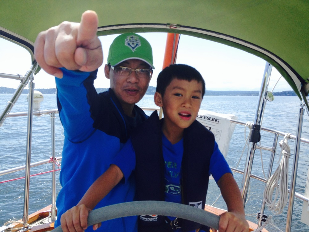 Papa Kiet navigates while Minh mans the helm.