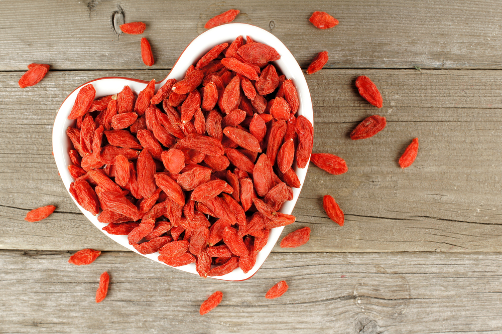 bigstock-Heart-shaped-bowl-of-goji-berr-85954604.jpg