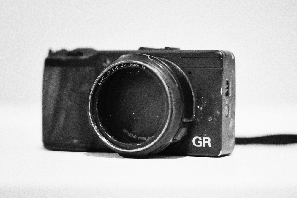 My beat up and dead Ricoh GR- GX7 with Leica 50mm f1.4