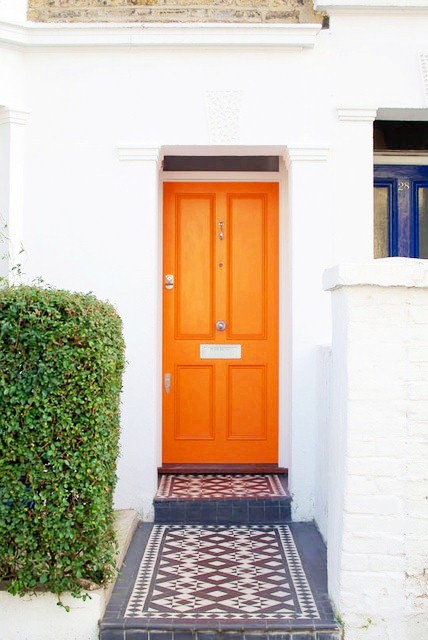 cococozy apartment therapy orange front door.jpg