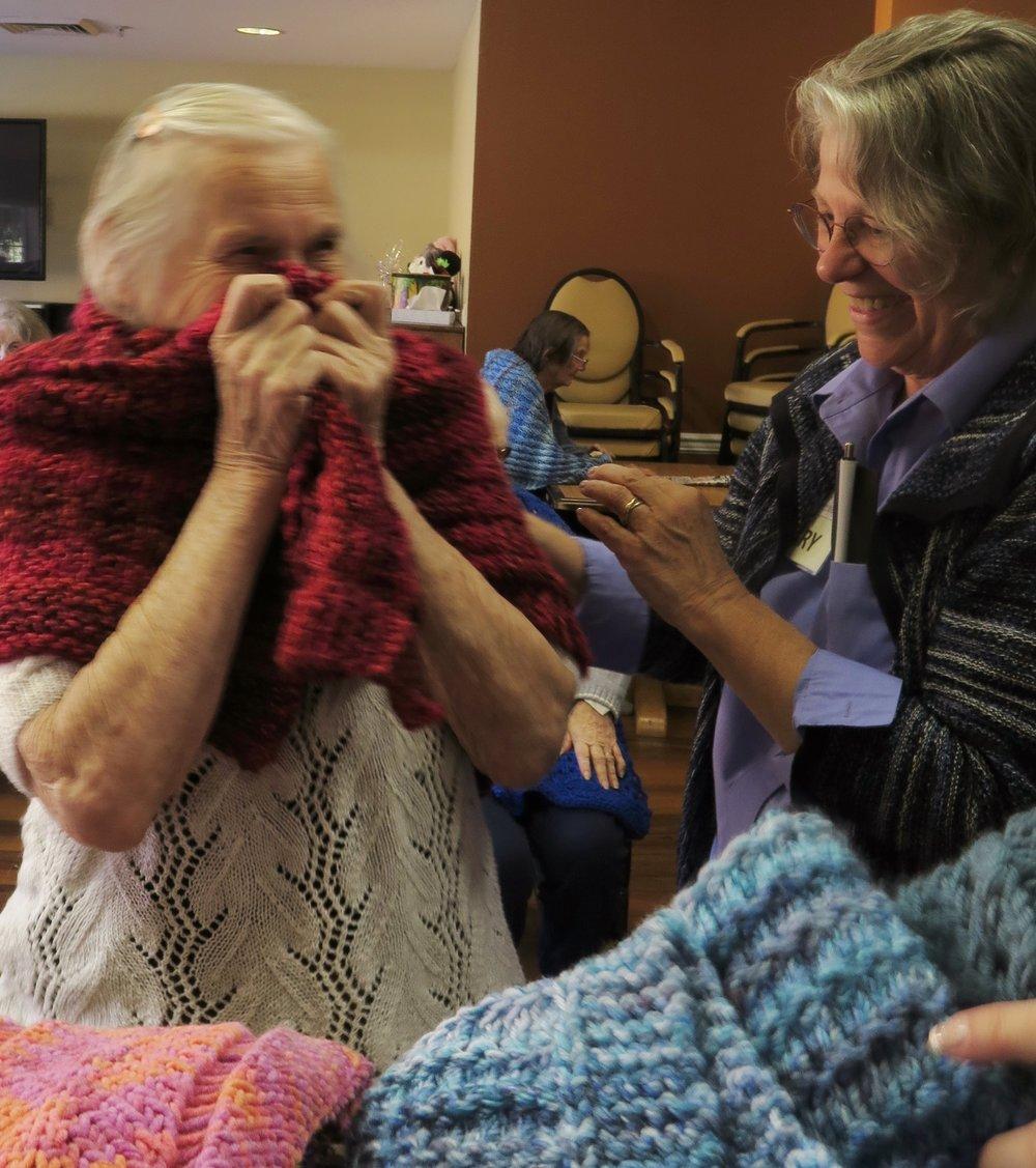 AE - Brookdale Reno Jackie snuggling gift.JPG