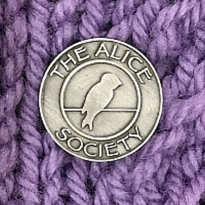 We're excited to announce the launch of The Alice Society.  The creation of this special society is a small way for us to acknowledge some of our amazing contributors.  Each person who knits or crochets at least 15 lap blankets or prayer shawls for Alice's Embrace and each person who gives $500 in monetary donations, or a combination of both, will receive this recognition and the pin shown above.  Our hope with creating The Alice Society is that the members will wear their pins and when asked, they will happily engage in conversations about what we do here at Alice's Embrace... since the pin is an eye-catcher, they will be asked.  As our donors qualify for The Alice Society, we will put the unique pin into the mail.