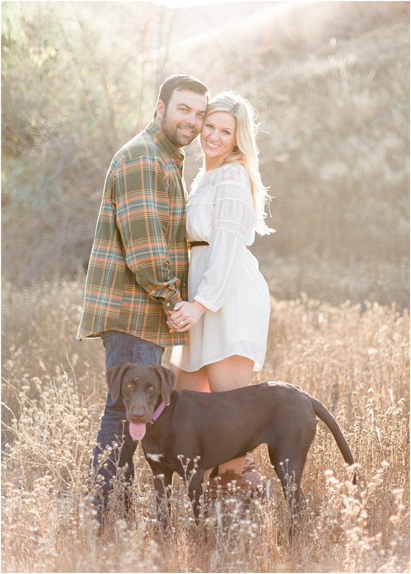 couple and their puppy