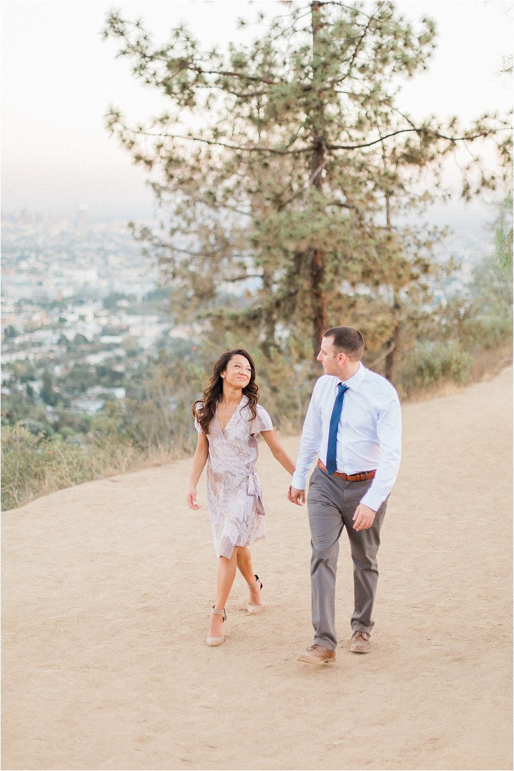 Couple Walking Griffith Observatory engagement