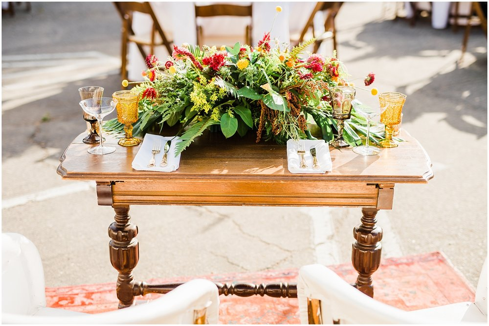 Alamo Motel Wedding sweetheart table florals