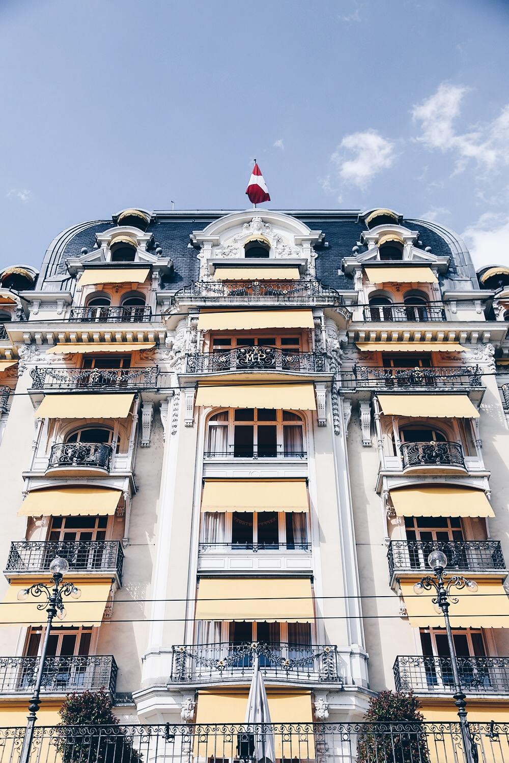 In one of our very first lists at This Is Glamorous had mentioned The Montreux Jazz Festival as one of the top five music festivals worth travelling for. The Fairmont Le Montreaux Palace could make its own list of places to see. Built in 1906, the Belle-Époque five-star luxury hotel sits on the shores of Lake Geneva, Switzerland. With 236 rooms, it is one of the largest hotels in the Swiss Riviera region. Here is but a glimpse . . .