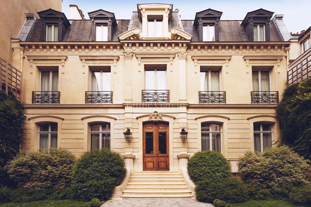 This beautiful 1,500 sqm 19th century town mansion sits between the Place des Vosges and the Ile Saint-Louis,. It comprises, at garden level, a double reception room, a study, a kitchen-diner, a glass-ceilinged dining room and a workshop; on the first floor, there is a large master suite with bathroom and closet opening onto the terrace, two children's rooms, one bathroom, a terrace and a games room; on the second floor, a library leading to four guest suites; on the first basement level, a media room, a recording studio, a wine cellar, a guitar room, a gym and a massage room; on the second basement level, a swimming pool with hammam and changing rooms. Also includes a triple garage and staff quarters (two bedrooms and studio).   View the listing here.