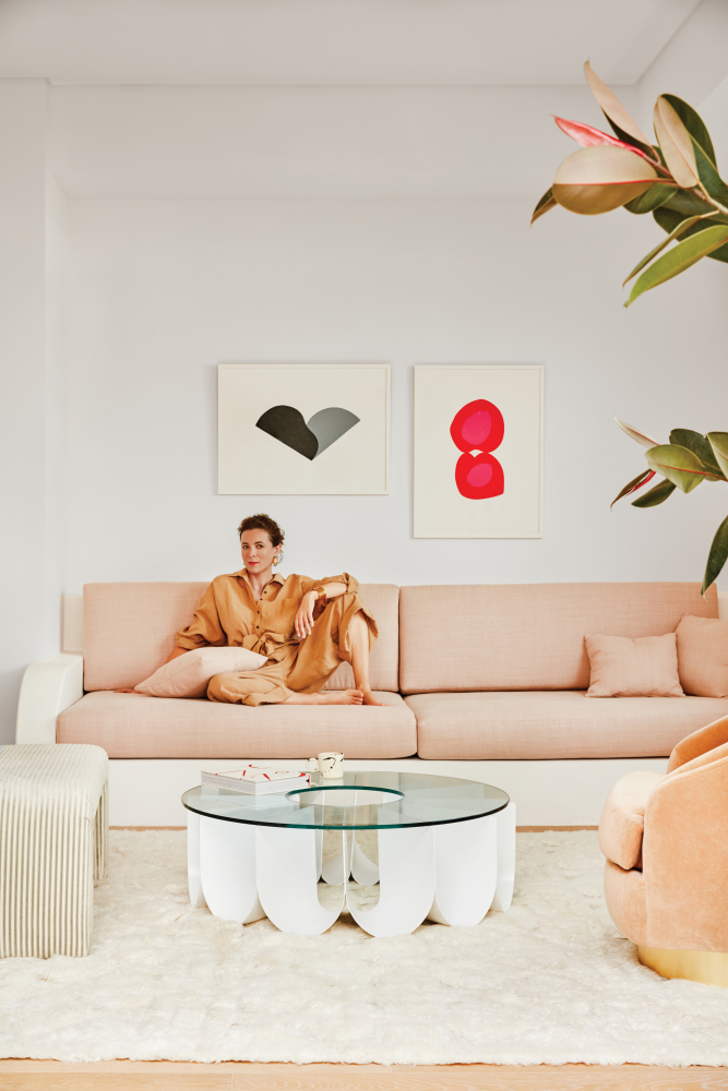 Despite rarely favouring modern spaces, we found ourselves drawn to Garance Doré's new California home. The bright, ultra-modern house in Mar Vista—with its unusual palette of red, pale peachy pink, blue and black—came together with the help of interior and product designer,  Sarah Sherman Samuel , who added large built-in sofas that really make all the difference…