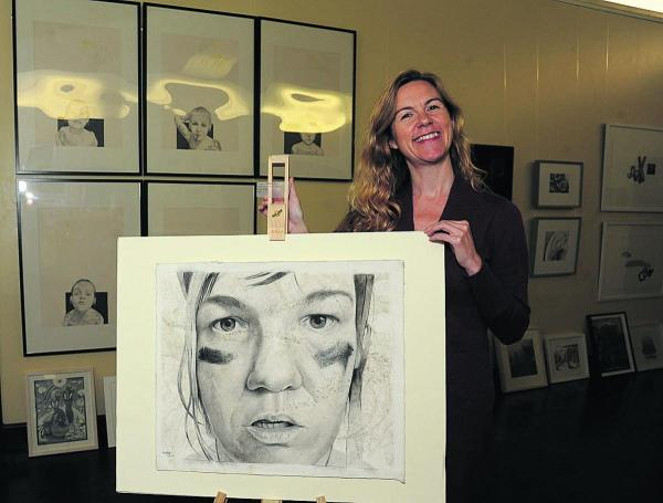 Tracy Sullivan, art director at Trowbridge Town Hall, with a roller derby portrait by Megan Foldenauer – one of the Derwent Art prize exhibits in the Town Hall