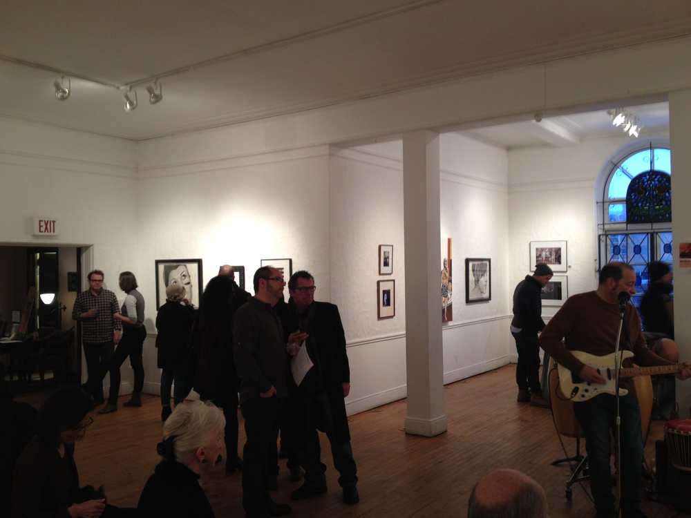 The portraits,  in situ , on opening night. Michigan Basement is playing on the right.