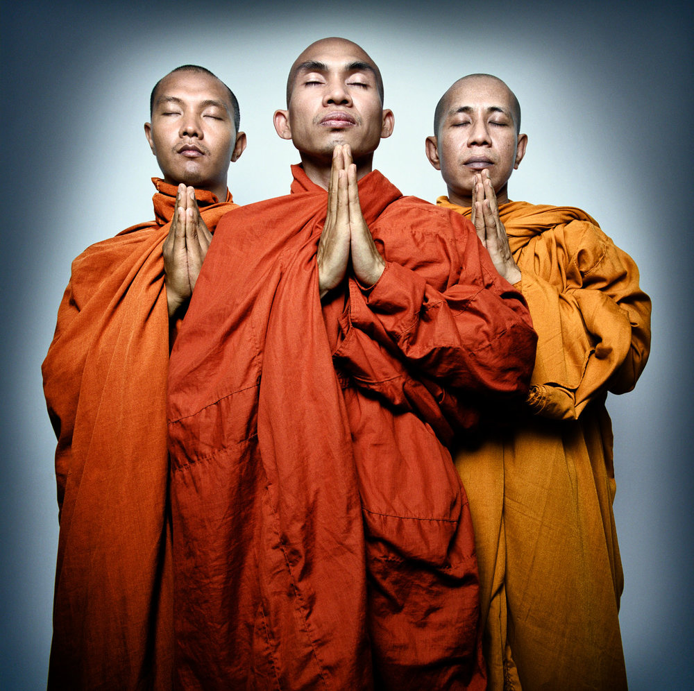 A group of monks pray. Left to right: Ashin Sopaka, Ashin Issariya, known as King Zero, and U Teza. September 2007 saw the largest popular protests against military rule in Burma in nearly 20 years, as monks left the relative safety of their monasteries to lead street protests, which came to be known as the Saffron Revolution. Burmese government security forces killed, beat, tortured, and violently dispersed peaceful protesters including monks. In the ensuing crackdown, Burmese courts sentenced hundreds of political activists and monks to long prison terms, some as long as 65 years.