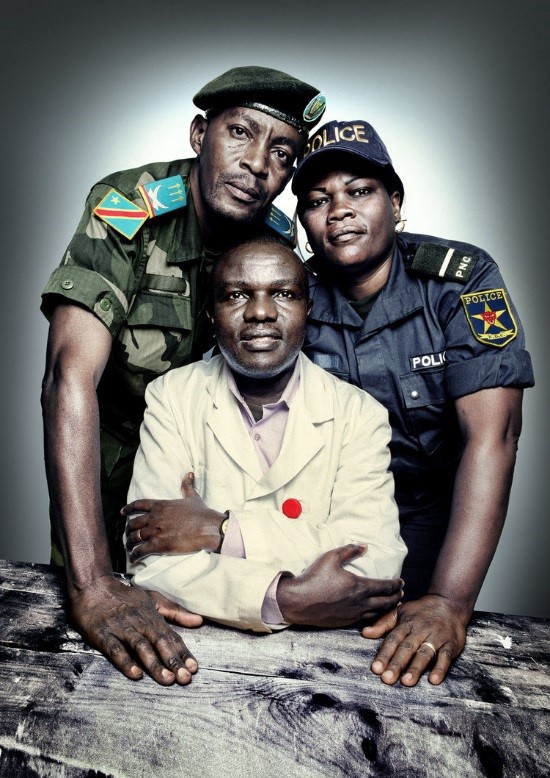 Captain David Kazadi Nzengu (standing left), a military prosecutor; Dr. Désiré Alumeti (seated), a pediatric surgeon at Panzi Hospital; and Honorata Uvoya (standing right), an officer in the Congolese police's Women and Child Protection Unit. All three trained in best forensic practices with PHR. | Platon for The People's Portfolio   Originally published at physiciansforhumanrights.org.