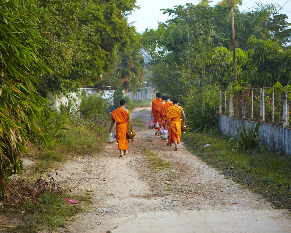 Monks on the run. Vientiane, Laos