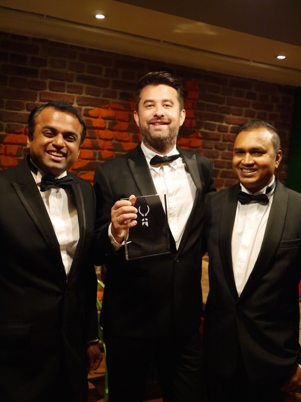 (L to R): Co-owners Kanthi Thamma & Euan Sey, plus Head Chef Gouranga Bera pose with the award